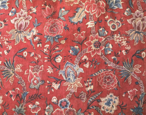 A photo shows a cotton fabric painted with an intricate floral design.
